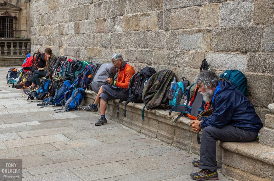 Minding the packs - Camino walkers in Santiago